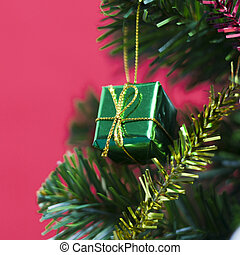 green gift on christmas on red background