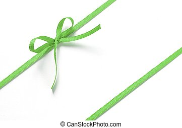green gift ribbon with bow isolated on white background