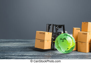 Green glass globe and forklift truck with cardboard boxes. Distribution and trade exchange goods around the world, retail and sales. Global business, import, export. Economic relations. Freight