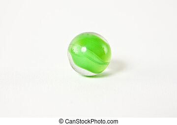 Green Glass Marble - A green glass marble on a white...