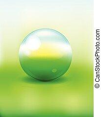 green glass sphere on bokeh backgro