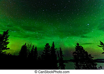 Green glow of Northern Lights or Aurora borealis - Green...