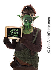 green goblin holding a slate with german text, not to be...