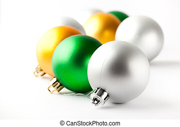 Green, gold and silver Christmas baubles on white