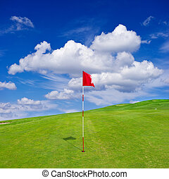 green golf field with cloudy sky