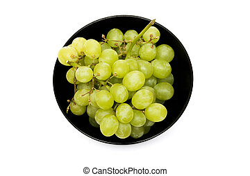 Green grapes in a black plate on a white background