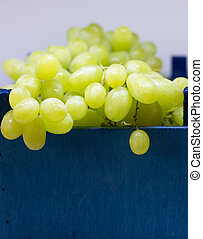 Green grapes in a blue wooden box