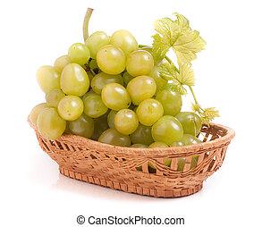 green grapes in a wicker basket isolated on white background