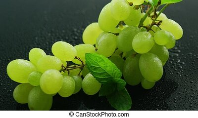 Green grapes on wet table - From above green grapes on...