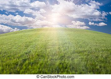Green Grass Field, Blue Sky and Sun