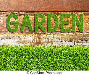 green grass garden word on wood background