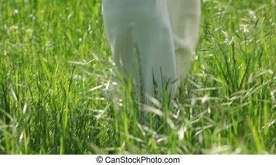 Green grass - Newly-weds walking on a green grass