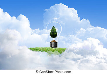 Green grass with tree and cloud sky background