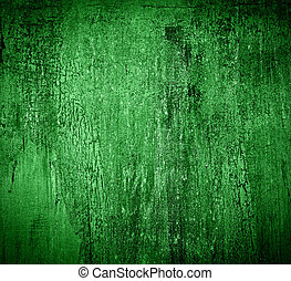 Green grunge background: stained and dirty wall