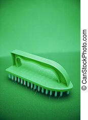 Green handle clothes brush