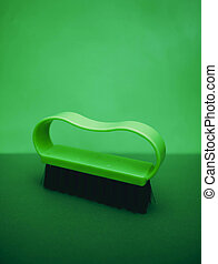 Green handle clothes brush with black bristles