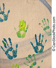 Green handprints on the wall