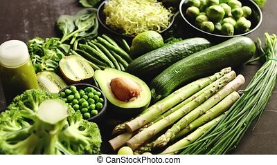 Green healthy food composition with avocado, broccoli, apple...