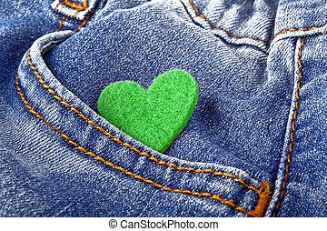 Green heart in jeans pocket