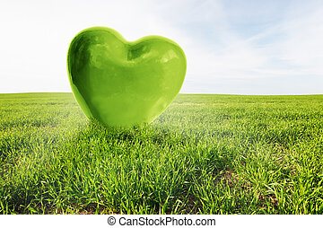 Green heart on the grassy field. Love, healthy environment, nature