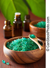 green herbal salt and essential oils for spa bath