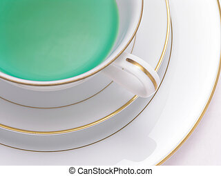 Green Herbal tea 4 - Green Herbal tea in a tea cup on saucer