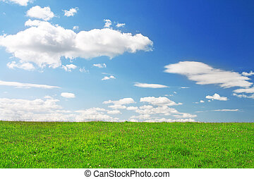 Green hill under blue cloudy sky