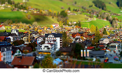 Green hills in swiss valley tilt shift view, sunny day,...