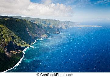 Green hills of Molokai island coastline.