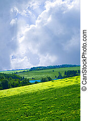 Green hills under the blue summer skies