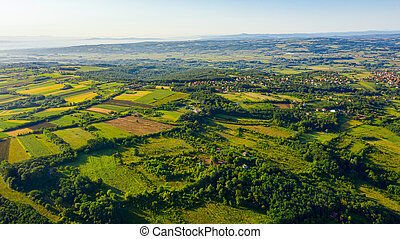 Green hilly landscape and small town