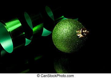 Green holiday decoration and ribbon