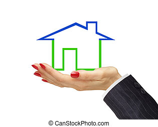 Green house in woman hand isolated on white background. Real estate