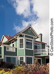 Green House - A coastal home against a cloudy sky