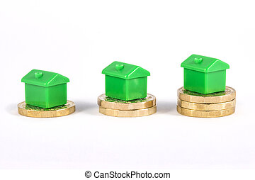 Green Houses Sitting on Top of Coins