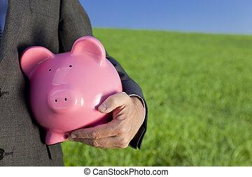 Green Investment Pink Piggy Bank - Green investment concept...