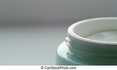 Green jar with the cosmetics gentle cream. Cosmetics cream...