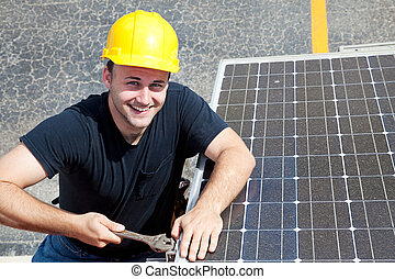 Green Job - Happy Worker - Handsome young electrician...