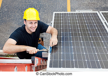 Green Jobs - Renewable Resources - Electrician installing...