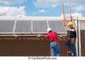 Green Jobs - Solar Power - Workers installing solar panels...