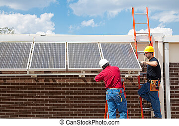 Green Jobs - Solar Power - Workers installing solar panels...
