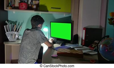 Green Key indoors Teenage Boy Playing Computer Close-Up Hands Game Video Sitting Back. young student examinations man working on the computer at home at night indoor in the dark