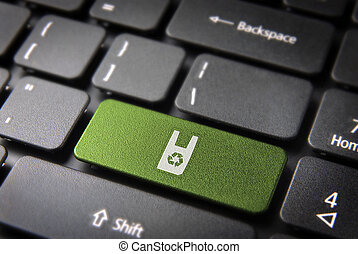 Green keyboard key with recycle plastic icon