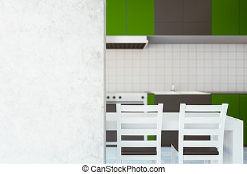 Green kitchen with blank wall
