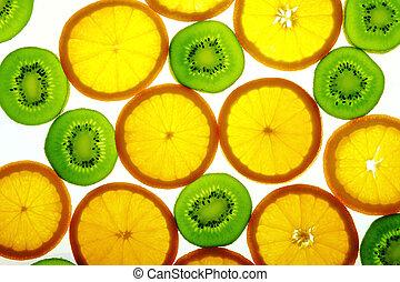 Green kiwi and orange slices