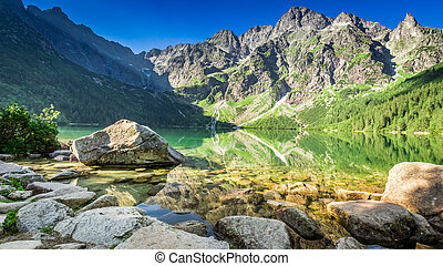 Green lake in the mountains at sunrise, Poland