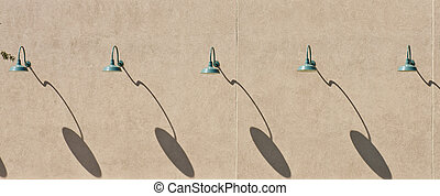 Green Lamps and Shadows on Brown Stucco Wall