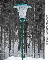 Green lantern in winter landscape