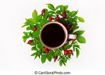 green leaves and red berries, flowers, Cup of coffee on a white background . Flat lay.
