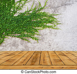 Green leaves ivy wall and wood floor for background